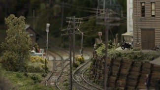 Adding Delicate Model Train Parts: Telephone Poles and Lines