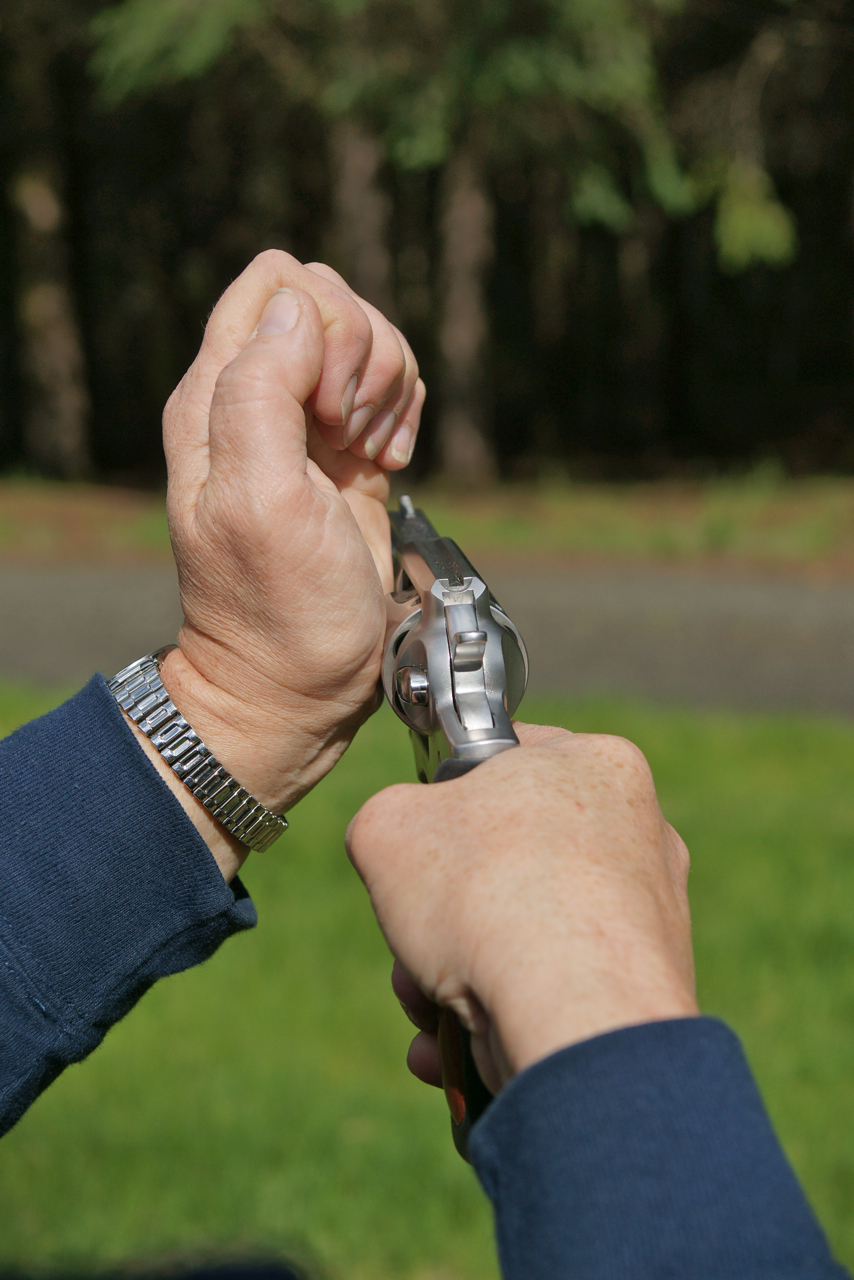 "The ""tap-stroke"": hit the left side of the cylinder with the heel of your hand and stroke the trigger."