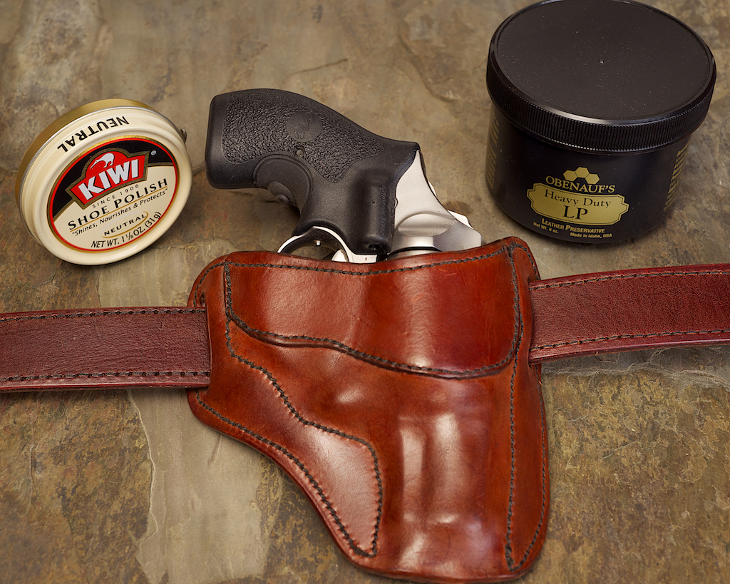 Leather holsters squeak because they're dry. Application of a neutral shoe polish or quality leather conditioner will rehydrate leather and eliminate squeak.