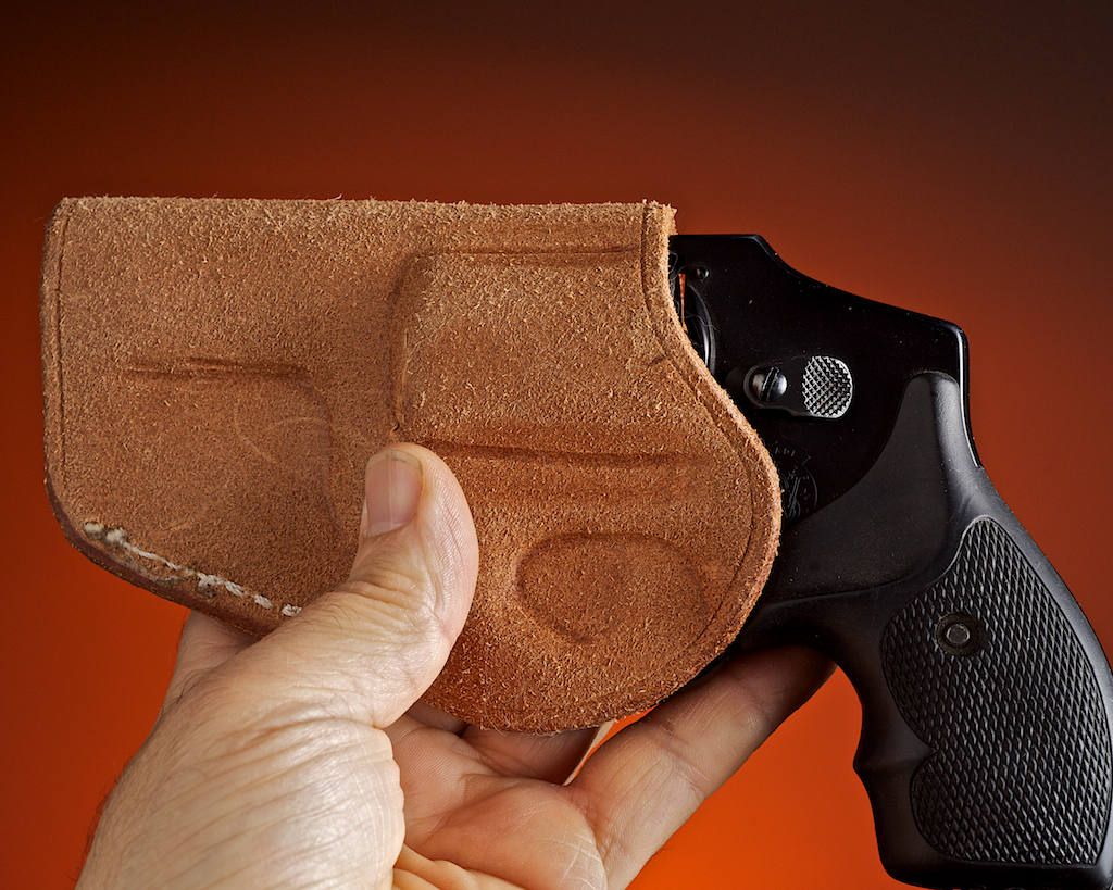 Leather with rough side out, like this model from Tucker Gunleather, or a holster with suede backing feels cooler in hot weather and is less likely to chafe.