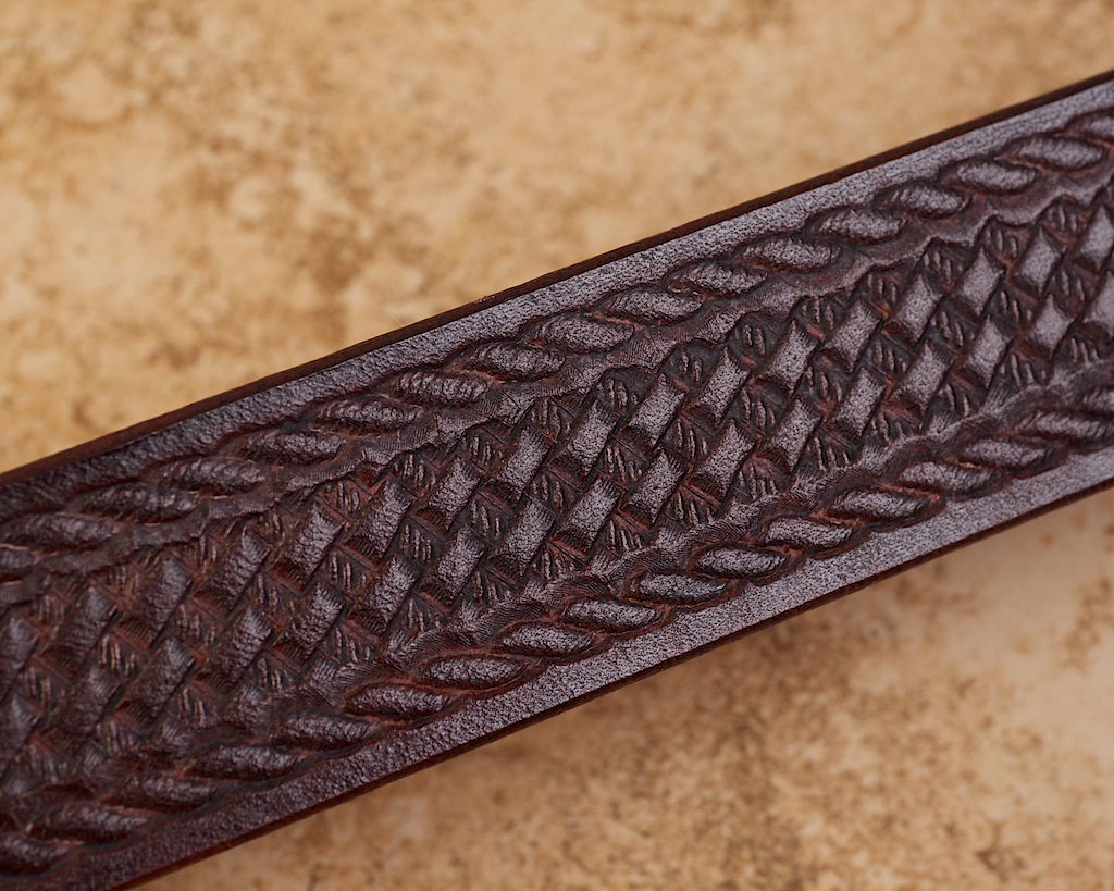 Stamped decoration on belts reduces noise signature and retains leather treatments longer.