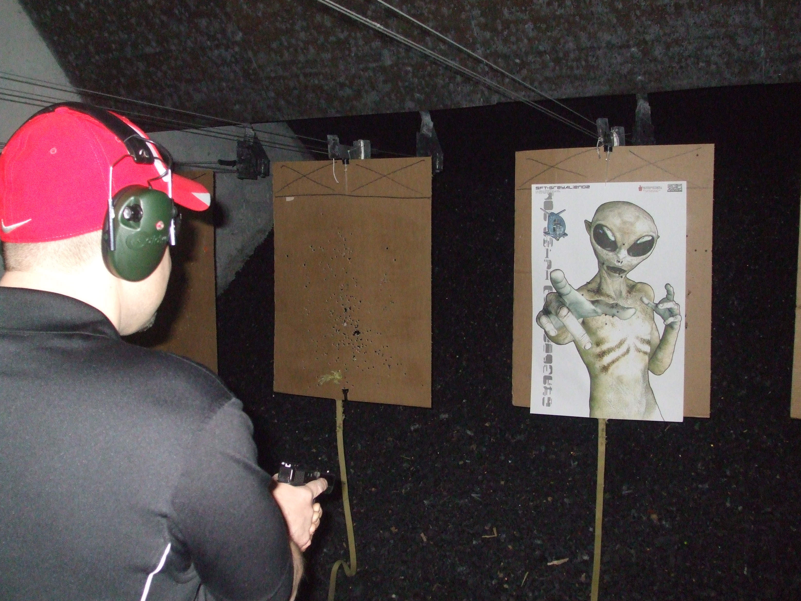 Shooter confronts alien during firearms training Low-Light Fight Drill.