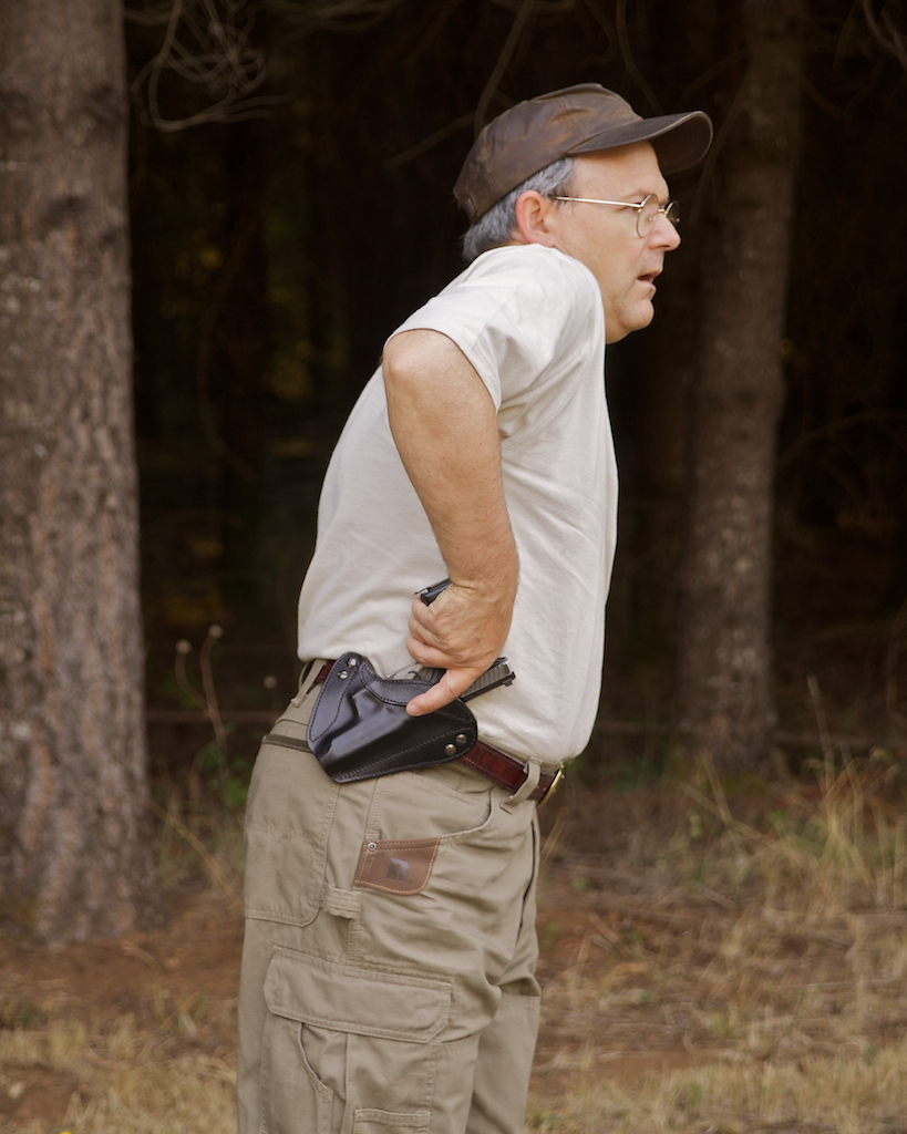 In an upright competition stance, canted holster forces gun to be pulled forward rather than upward, which is neither a strong nor natural motion.