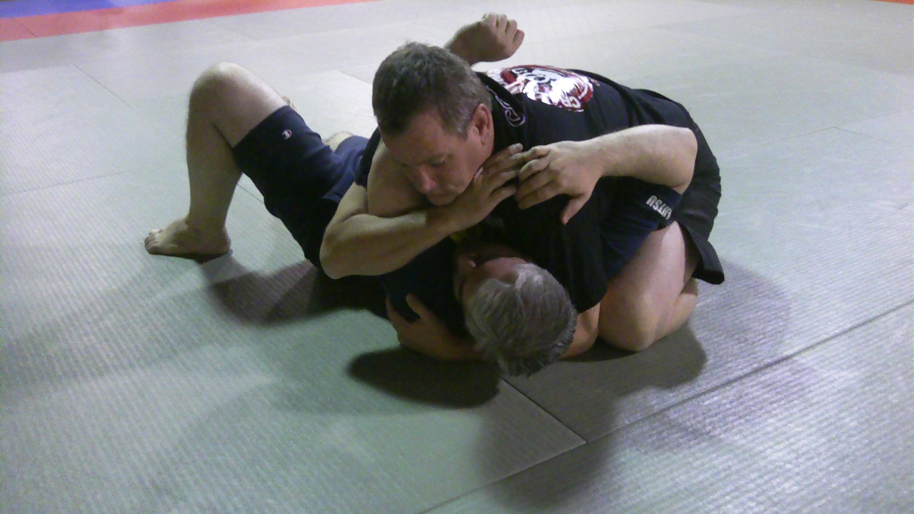 A standard BJJ position. How will the bottom guy use dirty tactics?
