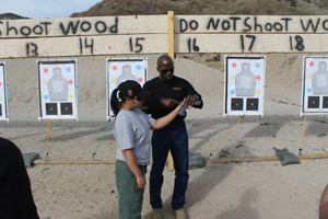 Image of an instructor providing proper technique for defensive shooting