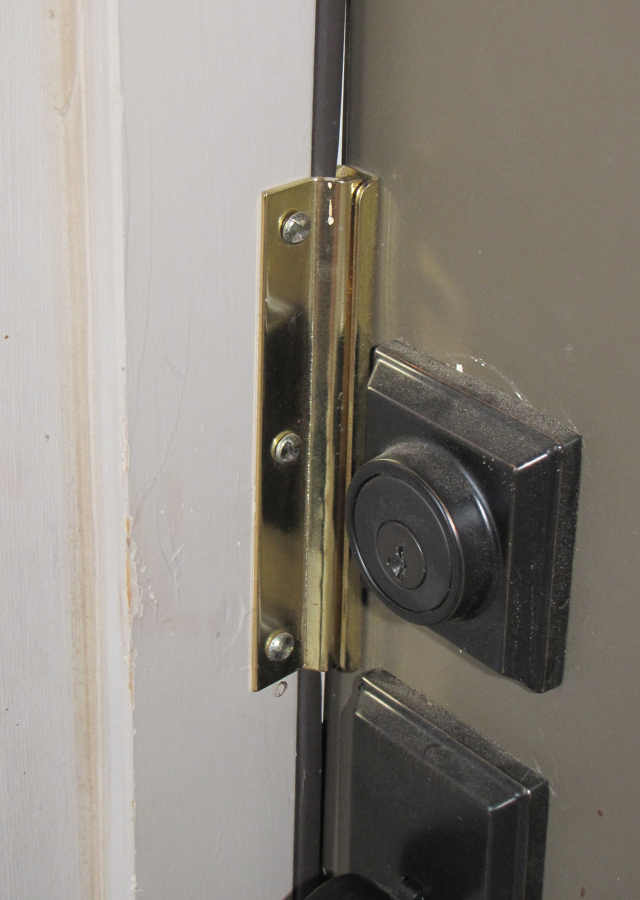 Image of an anti-pry shield for doors and windows