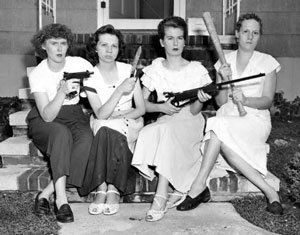 Image of four women holding weapons in 1950