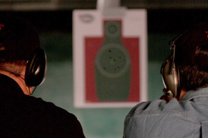 Image of two men practicing their target shooting training