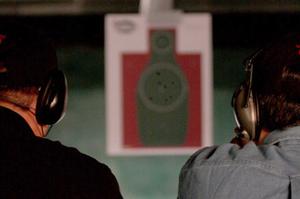Image of two men practicing their target shooting training