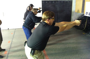 group of students being instructed on defensive firearm techniques