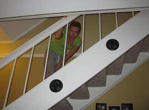 Girl looking down from the top of her stairs - Home Self Defense