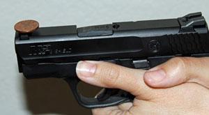 image of a gun balancing a penny