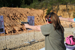 This is an image of a woman practicing shooting drills