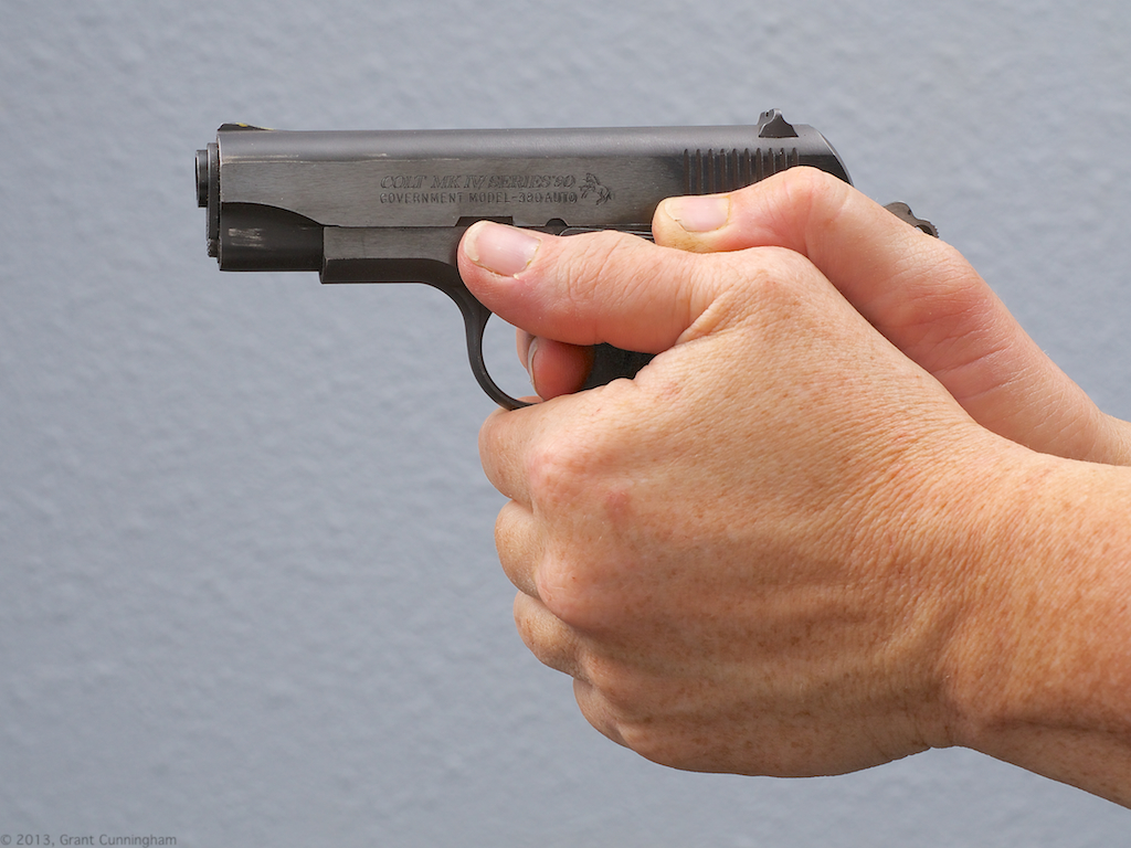 This is an image of a .380 pistol being held by its owner demonstrating combat accurate hits - Best personal defense weapon