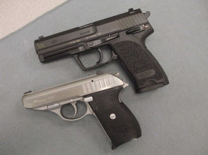 HK (top) and SIG Sauer pistols with frame-mounted decocking levers.