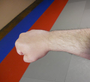 A proper fist: wrist flat, first two impact knuckles lined up with forearm.