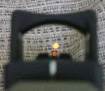 This shows how you can view the iron sights through the red dot scope. If the dot goes out during an engagement, simply pick up the irons and fire. The irons are also said to help the user find the dot faster.