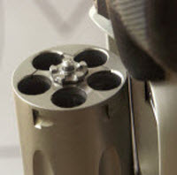 The latch pin hole is where the pin in the center of the cylinder's ejector star drops.