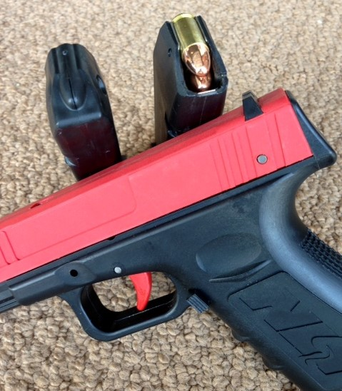 SIRT training pistol magazine alongside actual Glock 17 magazine loaded with ball ammunition. Not similar enough to trigger a confusion response. Photo: author