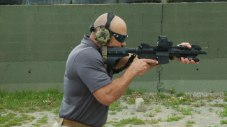 Steve Aryan demonstrating how one might shoulder fire an AR Pistol with a stabilizing brace during a defensive shooting situation.