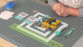 types of rotary cutters laid out on mat