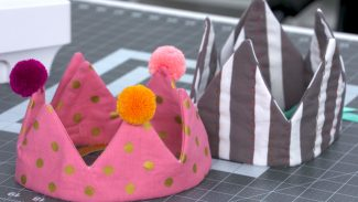 Sewing instructor shows how to sew a pink and striped crown for birthdays and other occasions