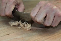 Using a wooden scraper