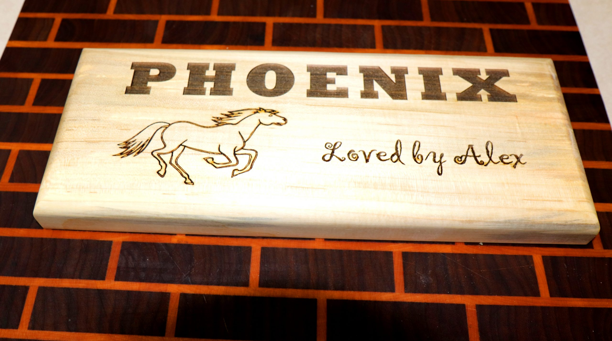 picture of a wooden engraved sign