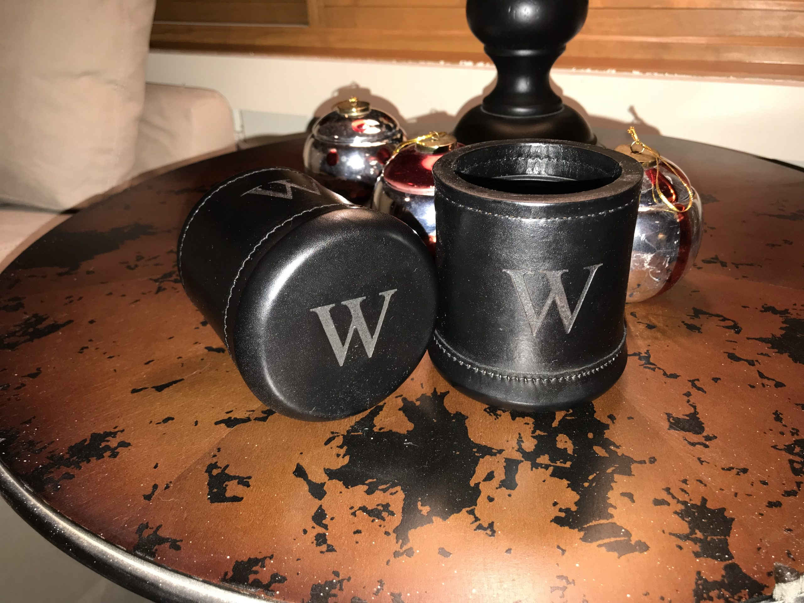 laser engraving of a W on leather cups