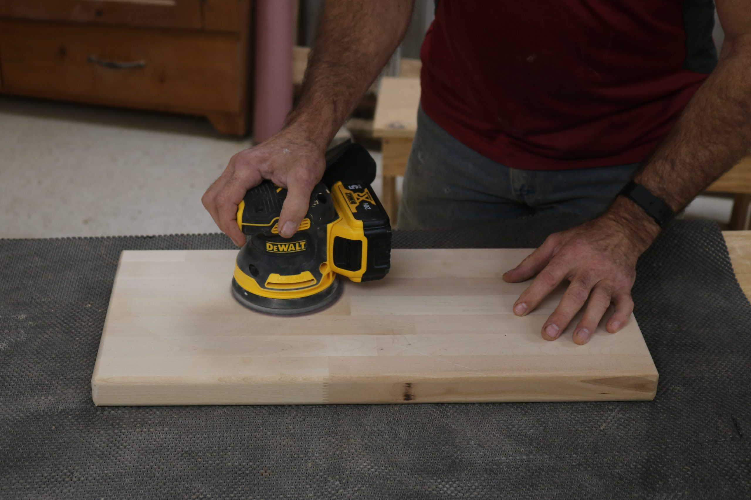 close up of a cordless sander in use