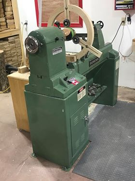 photo of the lewis golden lathe in a woodworking shop
