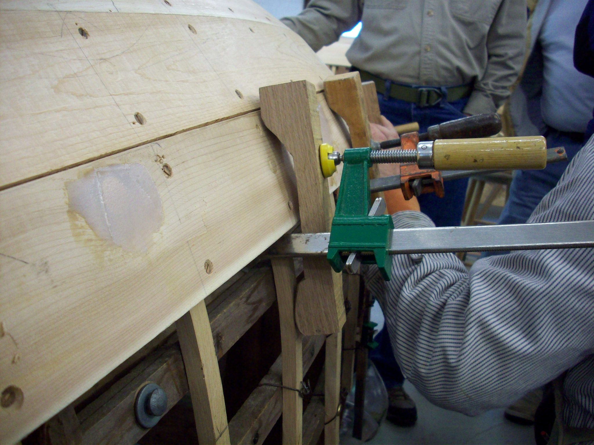 Clamps and blocks holding planks into place